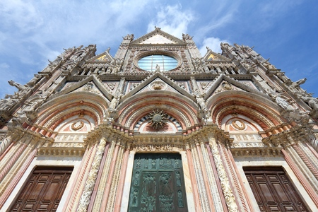 Siena, Italy - medieval town of Tuscany. Cathedral facade. Stock Photo