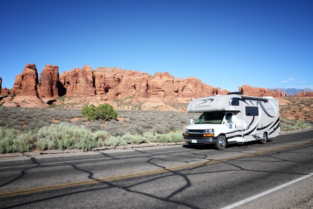 UTAH, UNITED STATES - JUNE 21, 2013: Recreational vehicle drives in Arches National Park in Utah. Arches NP was visited by 1,070,577 people in 2012.
