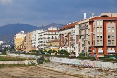 MALAGA, SPAIN - OCTOBER 4, 2014: Guadalmedina river canal in Malaga, Spain. According to UNWTO Spain was visited by 68.2 million tourists in 2015.