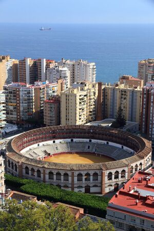 Malaga, Spain. Cityscape with hotels and bullring stadium. Stock Photo