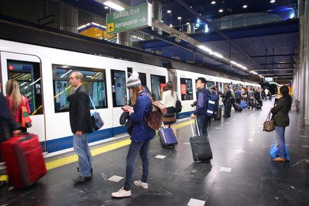 MADRID, SPAIN - OCTOBER 21, 2012: People wait for train at Madrid Metro. Madrid Metro has annual ridership of 634 million passengers (2011). Sajtókép