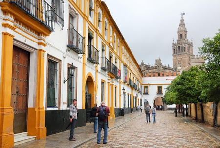 SEVILLE, SPAIN - NOVEMBER 3, 2012: People visit Seville, Spain. Seville is a major tourism destination in Spain with 4.8 million hotel-nights in 2011.