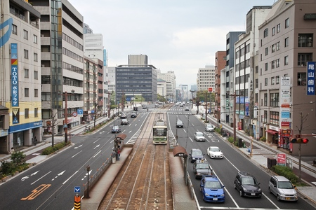 HIROSHIMA, JAPAN - APRIL 21, 2012: Street view in downtown Hiroshima, Japan. Completely destroyed by atomic bomb, Hiroshima is the largest city of Chugoku region with 1.17m population. Editoriali