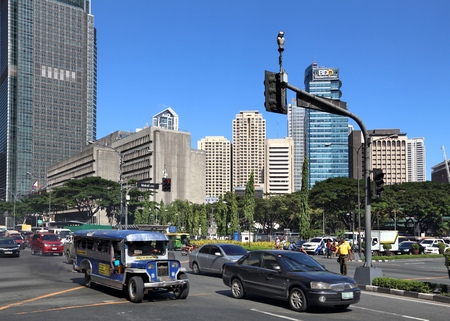 MANILA, PHILIPPINES - NOVEMBER 28, 2017: People drive in heavy traffic in Makati City, Metro Manila, Philippines. Metro Manila is one of the biggest urban areas in the world with 24 million people. Stock Photo - 91929042