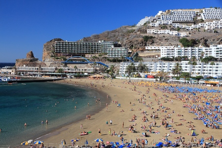 GRAN CANARIA, SPAIN - DECEMBER 2, 2015: People visit Puerto Rico Beach in Gran Canaria, Spain. Canary Islands had record 12.9 million visitors in 2014.