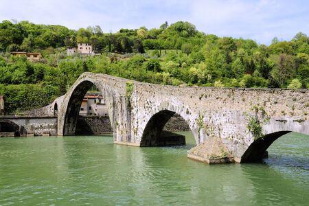 Ponte della Maddalena - important medieval bridge in Italy. Part of historical Via Francigena trade route in Tuscany. Also known as Devils Bridge.