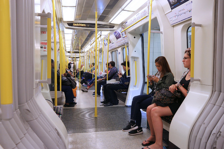 LONDON, UK - JULY 6, 2016: People ride the underground train in London. London Underground is the 11th busiest metro system worldwide with 1.1 billion annual rides.