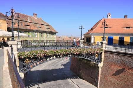 SIBIU, ROMANIA - AUGUST 24, 2012: People visit famous Bridge of Lies in Sibiu, Romania. Sibius tourism is growing with 284,513 museum visitors in 2001 and 879,486 visitors in 2009. 報道画像