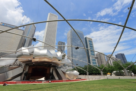 CHICAGO, USA - JUNE 27, 2013: Jay Pritzker Pavilion in Millennium Park in Chicago. Jay Pritzker Pavilion is a famous bandshell designed by Frank Gehry. Editorial
