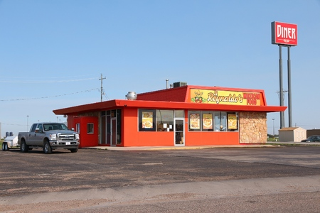 GOODLAND, USA - JUNE 25, 2013: El Reynaldos Mexican Food diner in Goodland, Kansas. There were 186,977 fast food restaurant locations and 30,898 full service restaurants in the US in 2016. Sajtókép
