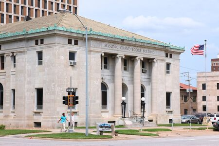 TOPEKA, USA - JUNE 25, 2013: People walk by Masonic Grand Lodge Building in Topeka, Kansas. Topeka is the capital city of the State of Kansas and is the 4th biggest populated area in Kansas. Redakční