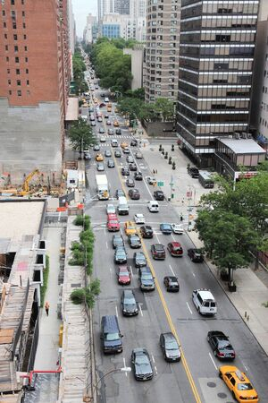 NEW YORK, USA - JULY 3, 2013: People drive in heavy traffic along 1st Avenue in New York. New York is among most congested cities in America. In 2009 average American spent 34 hours in traffic jams.