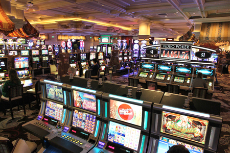 LAS VEGAS, USA - APRIL 14, 2014: People play at Bellagio resort in Las Vegas. The famous casino resort has almost 4,000 rooms.