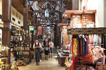 DUBAI, UAE - NOVEMBER 23, 2017: People shop at Souk Madinat Jumeirah in Dubai. The traditional Arab style bazaar is part of Madinat Jumeirah resort.
