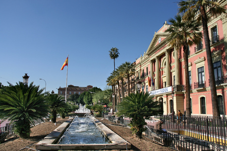 MURCIA, SPAIN - NOVEMBER 20, 2008: Park and architecture in Murcia city, Spain. Murcia is the 7th largest city in Spain with a population of 442,573.