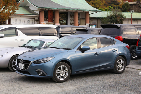 KYOTO, JAPAN - NOVEMBER 26, 2016: Mazda 3 compact sedan car parked in Kyoto, Japan. There are approximately 68.9 million cars registered in Japan.