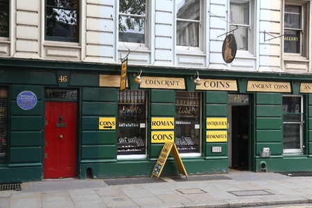 LONDON, UK - JULY 9, 2016: Coincraft store in London. The store located on Great Russell Street deals with numismatics, banknotes and antiquities.