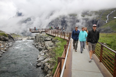 TROLLSTIGEN, NORWAY - JULY 20, 2015: People visit a viewpoint at Trollstigveien, Norway. Foreign tourists spent some 5 million overnight stays in Norway in 2013. Editorial