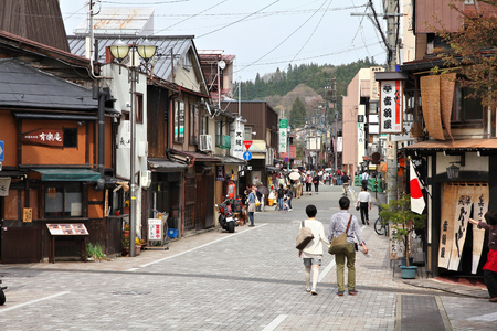 TAKAYAMA, JAPAN - APRIL 29, 2012: People visit the Old Town in Takayama, Japan. Takayama is an important tourism destination with well preserved old town.