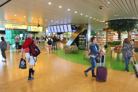 AMSTERDAM, NETHERLANDS - JULY 7, 2017: Travelers visit Schiphol Airport in Amsterdam. Schiphol is the 12th busiest airport in the world with more than 63 million annual passengers. Editorial