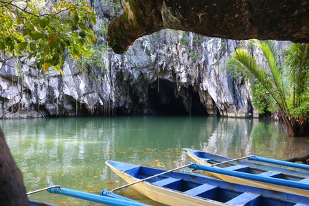 Puerto Princesa underground river entrance with tour boats in the foreground. Philippines nature.