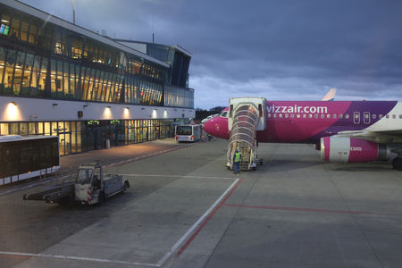 KATOWICE, POLAND - APRIL 8, 2012: Wizzair airline Airbus A320 parked at the terminal of Katowice Airport, Poland. Wizzair has a fleet of 88 Airbus aircraft.