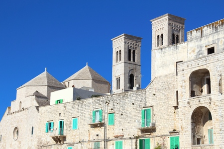 Molfetta town in Apulia, Italy. Residential architecture and Cathedral of Saint Conrad of Bavaria. Apulian Romanesque style.