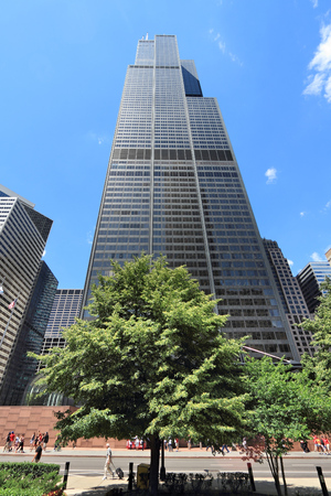 CHICAGO, USA - JUNE 28, 2013: People walk by Willis Tower (formerly Sears Tower) in Chicago. It is 442m tall and as of 2013 is the 2nd tallest building in the USA.