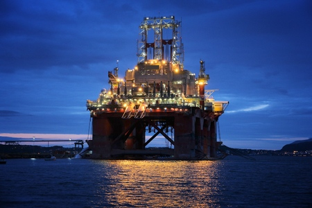 Offshore drilling rig under construction in a fiord in Norway. Oil industry structure. Stock fotó