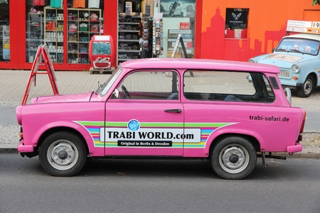 BERLIN, GERMANY - AUGUST 25, 2014: Colorful Trabant 601 cars parked in Berlin. 3,096,099 Trabant cars were produced despite their infamous inefficiency and outdated technology.