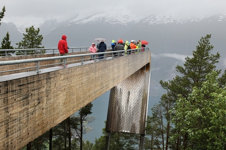 AURLAND, NORWAY - JULY 18, 2015: People visit the Stegastein platform - Aurlandsfjord fiord overlook in Norway. Norway had almost 5 million foreign visitors in 2011.