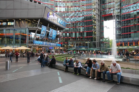 BERLIN, GERMANY - AUGUST 26, 2014: People visit Sony Center in Berlin. The modern complex was completed in 2000 and is Sony European headquarters. Редакционное