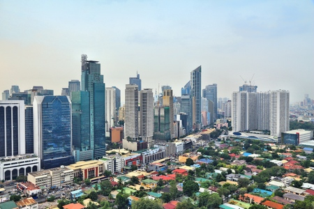 Makati city skyline in Manila, Philippines. Office buildings.