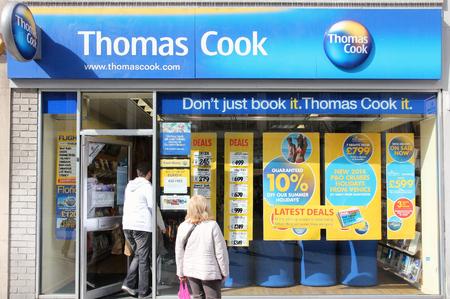 LIVERPOOL, UK - APRIL 20, 2013: People visit Thomas Cook travel agency in Liverpool, UK. Thomas Cook Group is a global vacation company with 22,672 employees (2014). Redakční