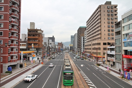 HIROSHIMA, JAPAN - APRIL 21, 2012: Street view in downtown Hiroshima, Japan. Completely destroyed by atomic bomb, Hiroshima is the largest city of Chugoku region with 1.17m population. Foto de archivo - 115573611