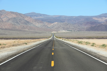 Death Valley road - empty route in Mojave Desert, California. Stock Photo