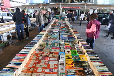 LONDON, UK - APRIL 23, 2016: People visit London South Bank Book Fair. Its a year round second hand book marked under Waterloo Bridge.