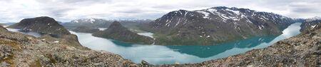 Norway landscape in Jotunheimen National Park. Besseggen mountain ridge trail between two lakes (Gjende and Bessvatnet). Wide panorama. Stock Photo