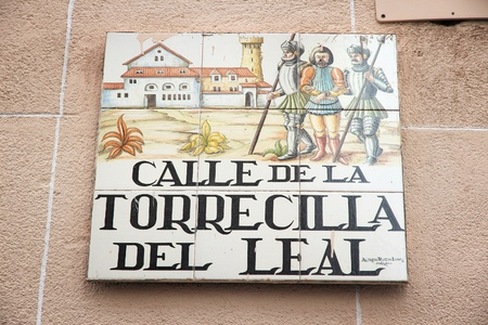MADRID, SPAIN - OCTOBER 24, 2012: Calle de la Torrecilla Del Leal typical street sign in Madrid, Spain. Artistic ceramic tile signs are typical for Madrid. Editorial