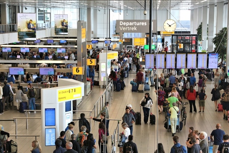 AMSTERDAM, NETHERLANDS - JULY 11, 2017: Travelers visit Schiphol Airport in Amsterdam. Schiphol is the 12th busiest airport in the world with more than 63 million annual passengers. Editorial