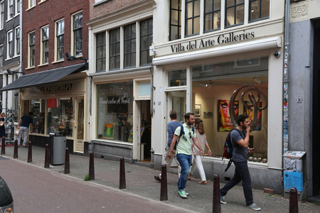 AMSTERDAM, NETHERLANDS - JULY 10, 2017: People walk along Nieuwe Spiegelstraat, antique shopping street in Amsterdam, Netherlands. Amsterdam is the biggest city and capital of the Netherlands. Editorial