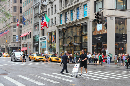 NEW YORK, USA - JULY 1, 2013: People shop at 5th Avenue, New York. 5th Avenue is ranked the most expensive retail area (per square foot) in the world.