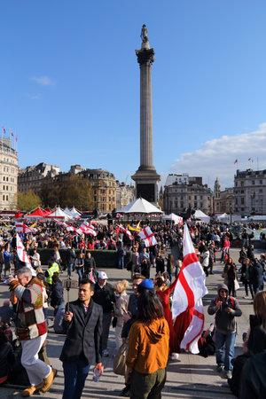 LONDON, UK - APRIL 23, 2016: People visit Trafalgar Square for Saint George's Day in London, UK. Saint George is the patron saint of England.
