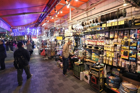 TOKYO, JAPAN - DECEMBER 1, 2016: People visit an electronic components store in Akihabara district of Tokyo, Japan. Akihabara is also known as Electric Town district, it has reputation for its electronics stores.