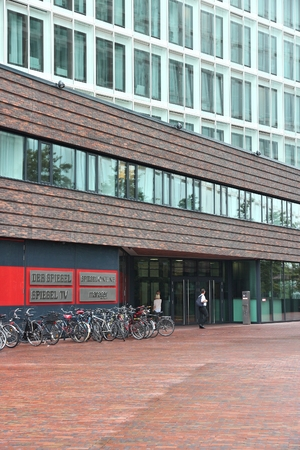 HAMBURG, GERMANY - AUGUST 29, 2014: People visit Der Spiegel magazine office in Hamburg. It is one of largest news magazines in Europe with circulation of 1 million per week. 報道画像