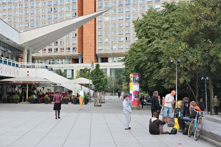 BERLIN, GERMANY - AUGUST 25, 2014: People visit the Alexander Square (Alexanderplatz) in Berlin. Berlin is Germanys largest city with population of 3.5 million. Editorial