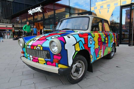BERLIN, GERMANY - AUGUST 25, 2014: Colorful Trabant 601 car parked in Berlin. 3,096,099 Trabant cars were produced despite their infamous inefficiency and outdated technology.