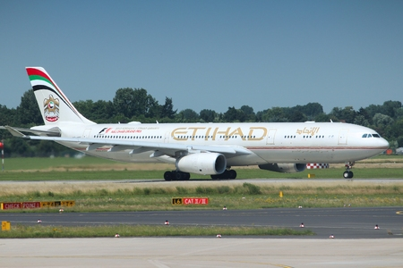 DUSSELDORF, GERMANY - JULY 8, 2013: Airbus A330 of Etihad Airways in Dusseldorf Airport, Germany. Etihad carried 14.8 million passengers in 2015.