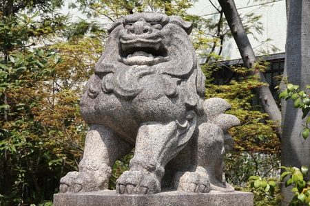 Komainu statue in Kyoto, Japan. The lion-dog statues are often guardians of shrines in Japan.