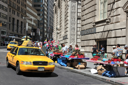 NEW YORK, USA - JULY 6, 2013: People ride yellow taxi in Lower Manhattan in New York. As of 2012 there were 13,237 yellow taxi cabs registered in New York City.